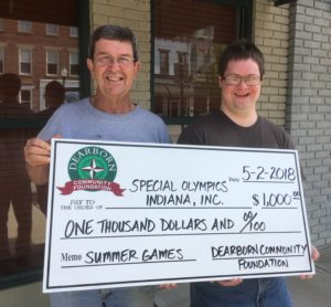 Dearborn Community Foundation Board member Bill Ward, left, delivers a $1,000 grant check to Special Olympian Ian Alexander. The DCF grant monies are to help athletes involved in Special Olympics Indiana Ripley-Ohio-Dearborn Counties to attend the 2018 Summer Olympics.