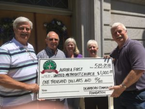Dearborn Community Foundation Board member Randy Tyler, right, delivers a $1,000 grant check to members of the Aurora First United Methodist Church (from left to right): Roger Fehling, Ken Elder, Ann Elder and Bonnie Nocks. The DCF grant monies are to help the church restore its flood-damaged basement kitchen, which is often used for charitable activities in the community.